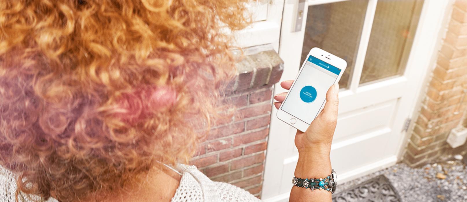 Caregiver using the cKey app to open the door